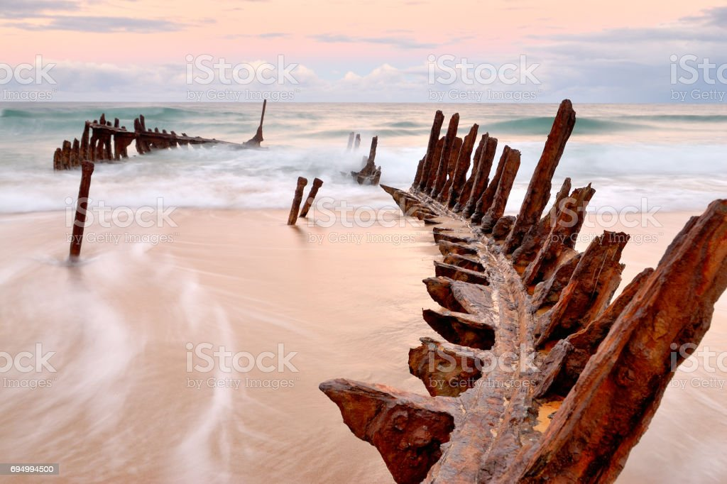 Dicky Wreck at dawn on Dicky Beach stock photo