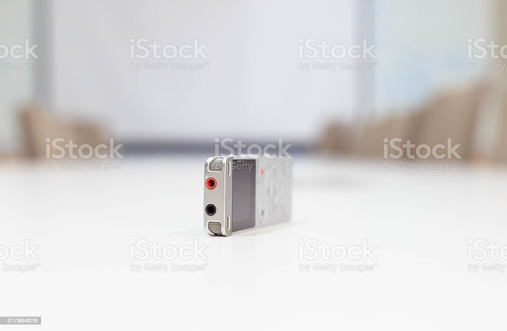 Dictaphone on the white table stock photo
