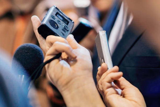 dictaphones recording interview with politician - recorder stock photos and pictures