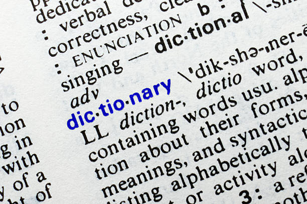 Dictionary. Closeup of dictionary word entry. stock photo