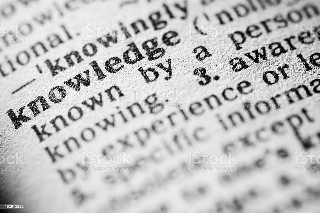 Dictionary definition of knowledge in black type royalty-free stock photo