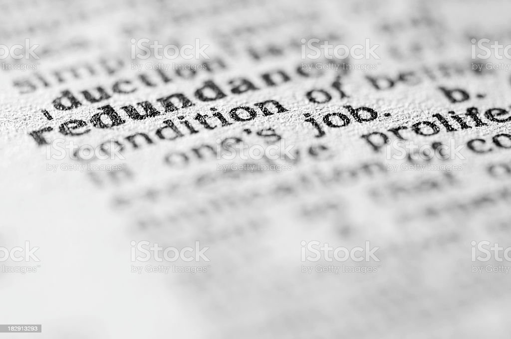 Dictionary definition of redundancy in black type stock photo