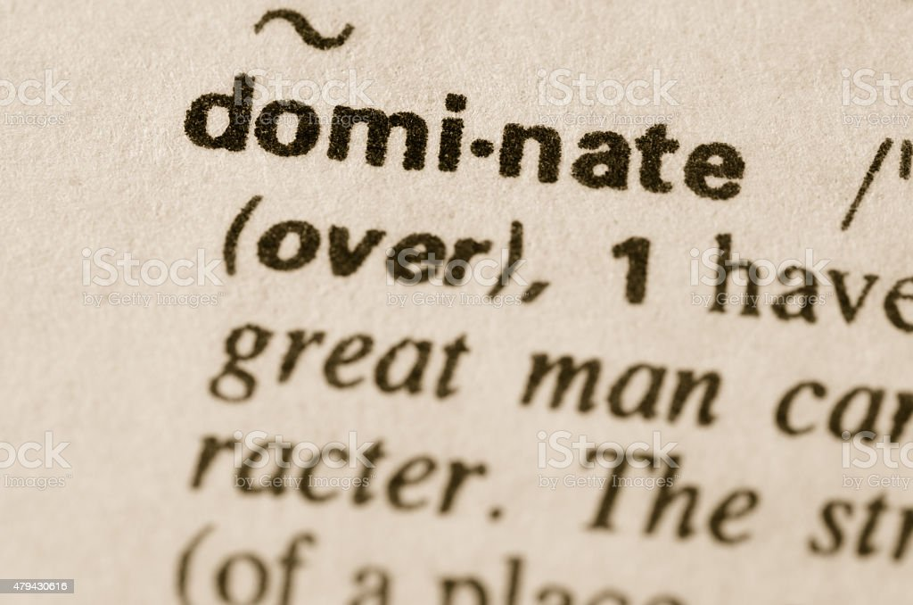 Dictionary definition of word dominate stock photo