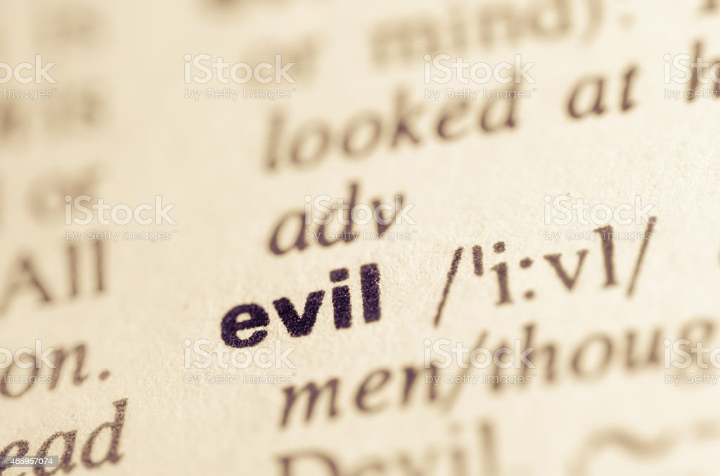 Dictionary definition of word  evil stock photo