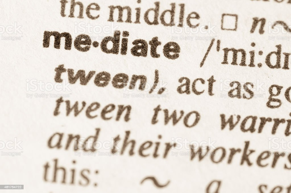 Dictionary definition of word mediate stock photo