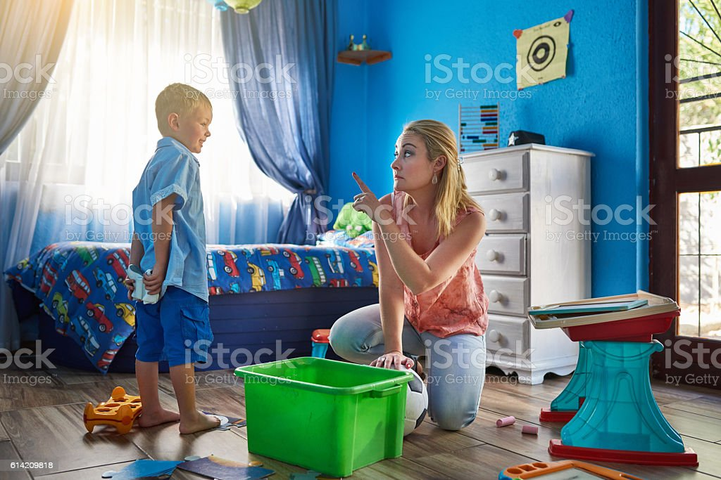Did I not ask you to pack your toys away? stock photo