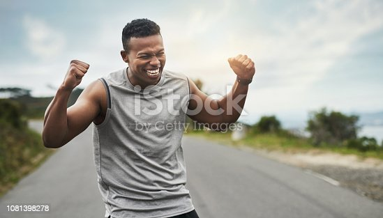 Cropped shot of a handsome young sportsman cheering in celebration outside