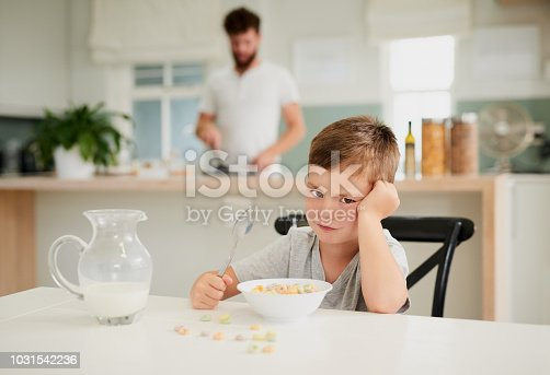 Shot of a little boy refusing to eat his breakfast at home
