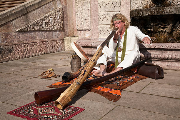 didgeridoo-player - didgeridoo stock photos and pictures