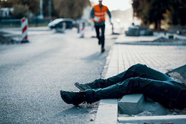 Died person on the street after accident at roadworks. Result of non-compliance with health and safety regulations Died person on the street after accident at roadworks. Result of non-compliance with health and safety regulations misfortune stock pictures, royalty-free photos & images