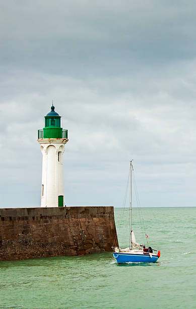 Dieppe Lighthouse Lighthouse and quay, Dieppe harbour France dieppe france stock pictures, royalty-free photos & images