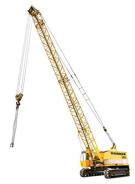 diesel electric yellow crawler crane isolated - crane construction machinery stock pictures, royalty-free photos & images
