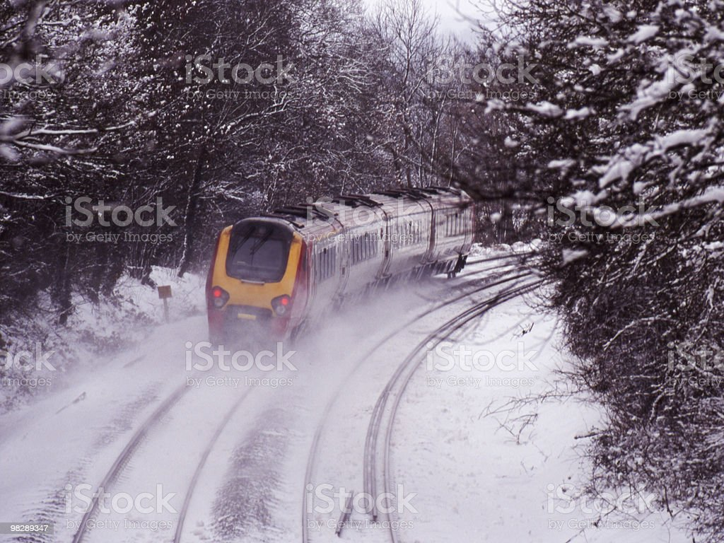 Diesel Express Train in Snowy Countryside royalty-free stock photo
