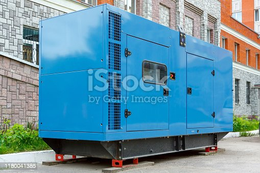 istock Diesel generator for emergency power supply at the wall of the medical center in good weather 1180041385