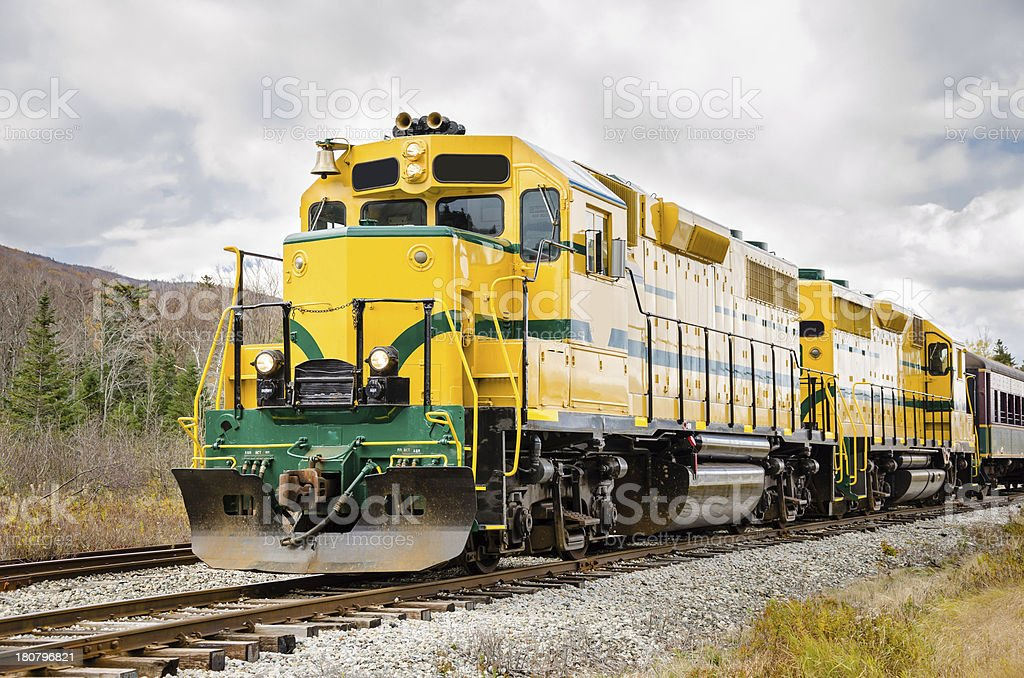 Diesel locomotive in yellow and green stock photo