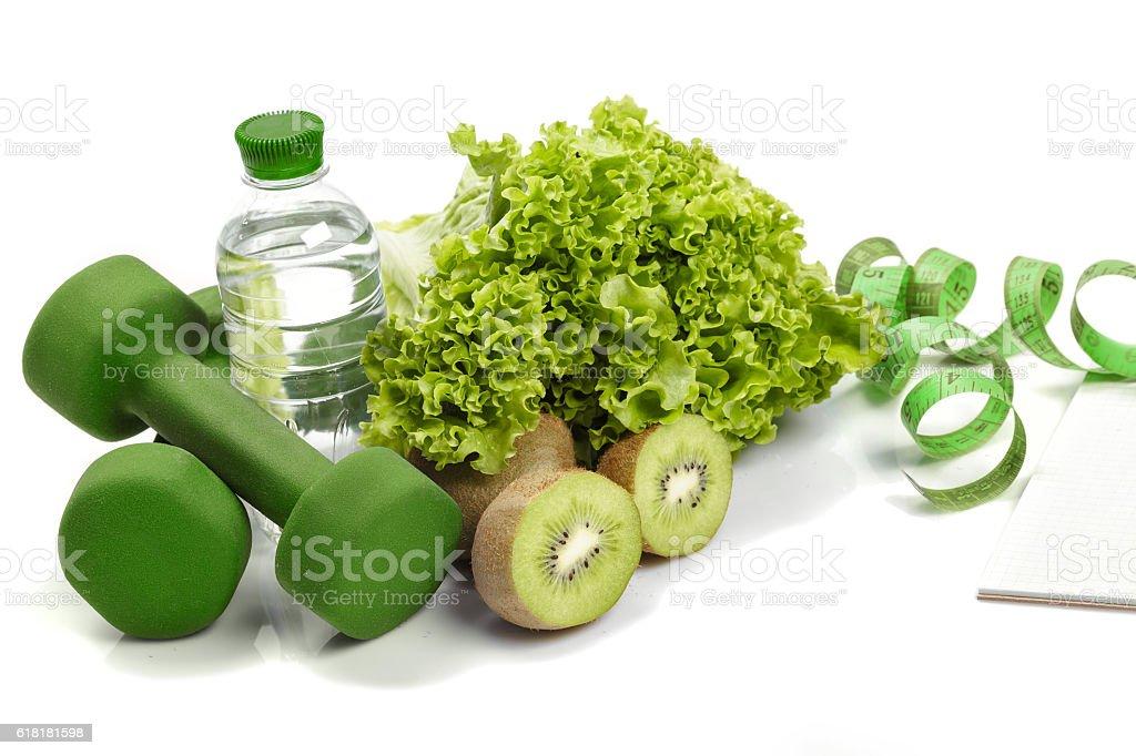 diet and detox . dumbbells, kiwi  water stock photo