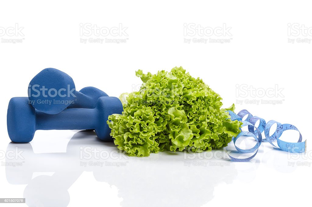 diet and weight loss, detox . dumbbells, lettuce  measuring foto stock royalty-free