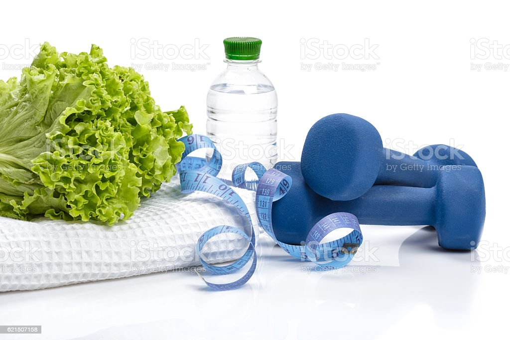 diet and weight loss, detox . dumbbells, lettuce  water stock photo