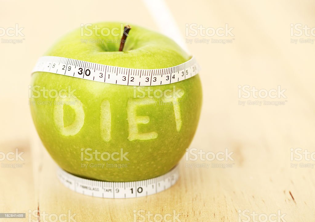 Diet, apple and measuring tape royalty-free stock photo