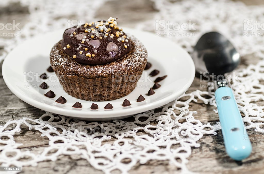 Diet chocolate cupcakes on white plate with pink spoon royalty-free stock photo