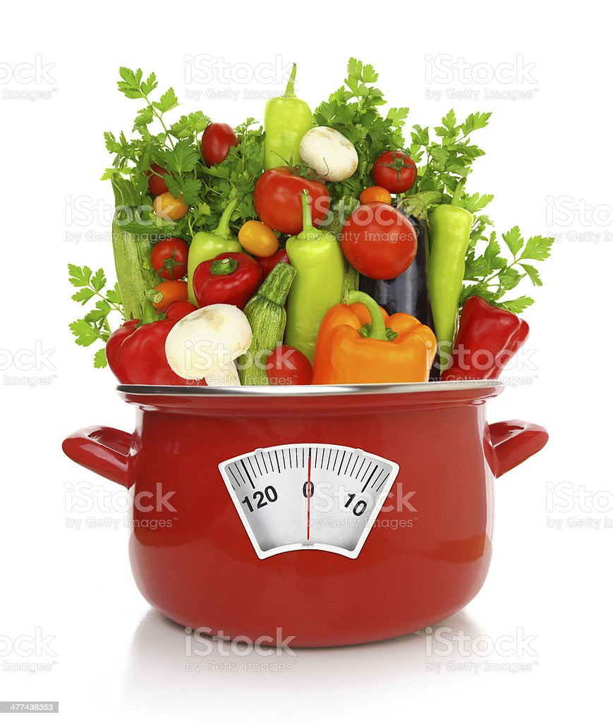 Diet concept. Colorful vegetables in a red cooking pot royalty-free stock photo