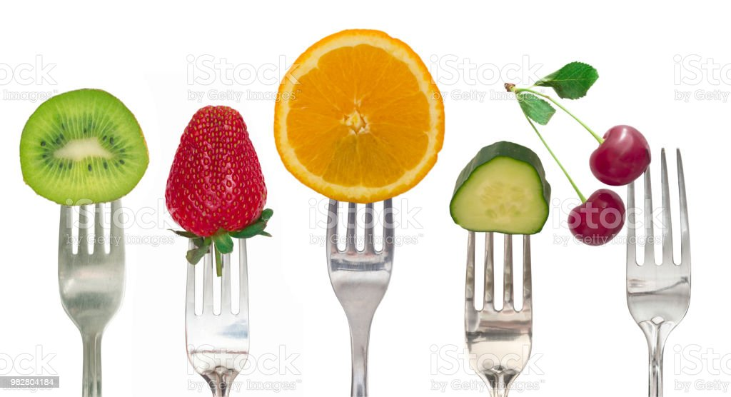 Diet concept, fruit and vegetables on the forks stock photo