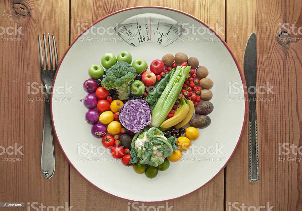 Diet concept heart shape fruit and vegetables - foto de stock