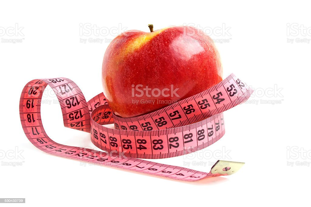 Diet concept - red apple and measuring tape stock photo