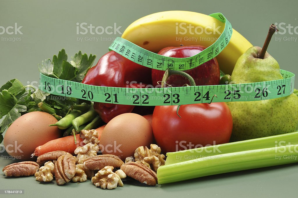 Diet concept with tape measure and healthy food stock photo