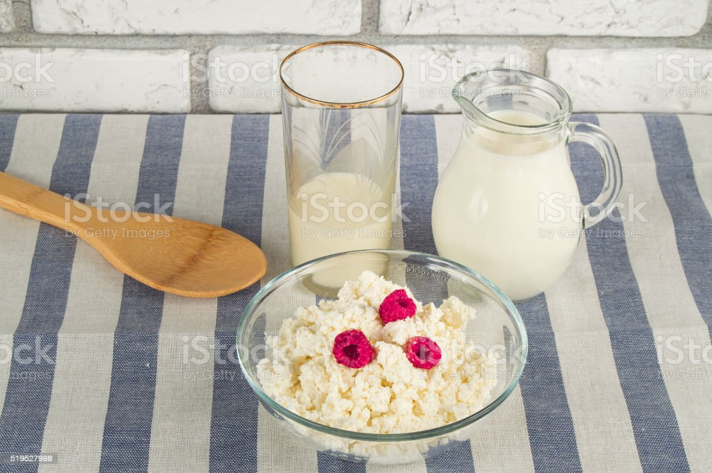diet cottage cheese with fresh raspberries and milk stock photo