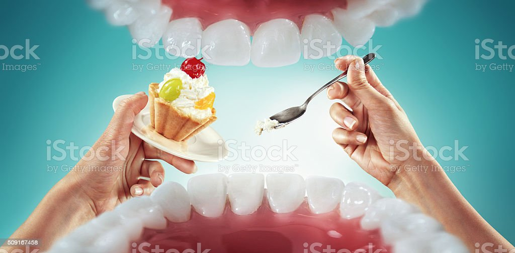 Diet. Fast food and sweets. View from mouth. stock photo