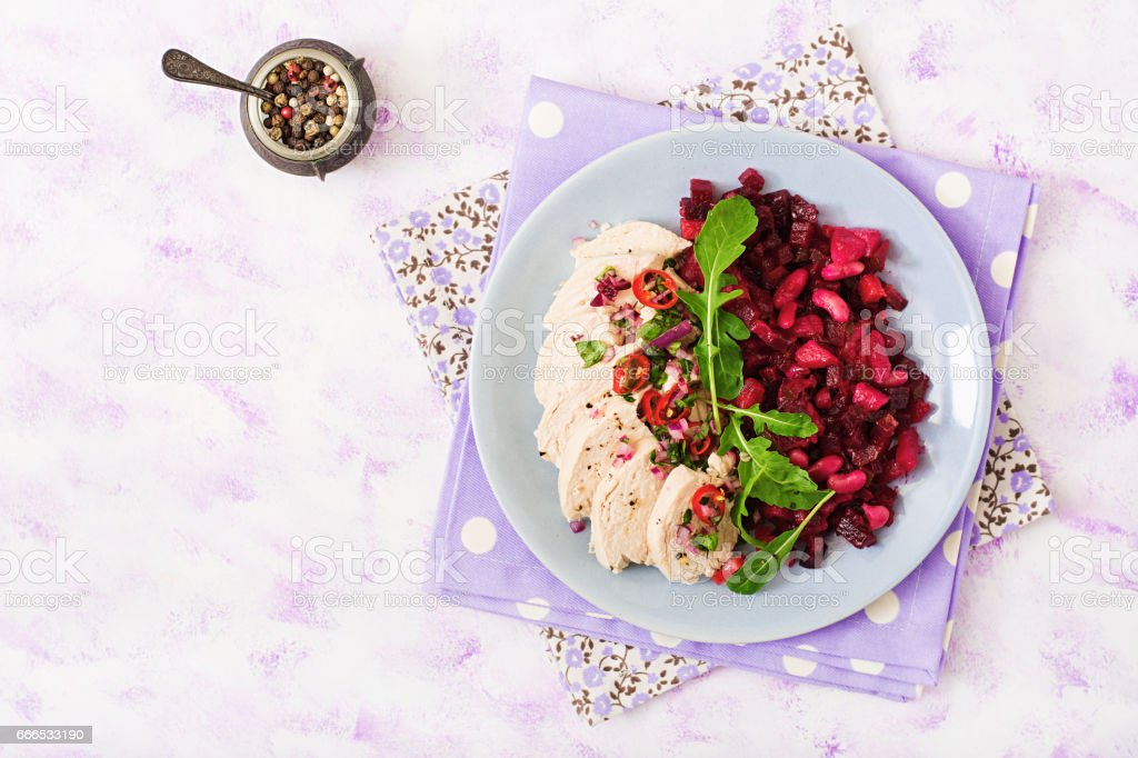 Diet food. Chicken breast with a garnish of boiled beets and white beans. stock photo