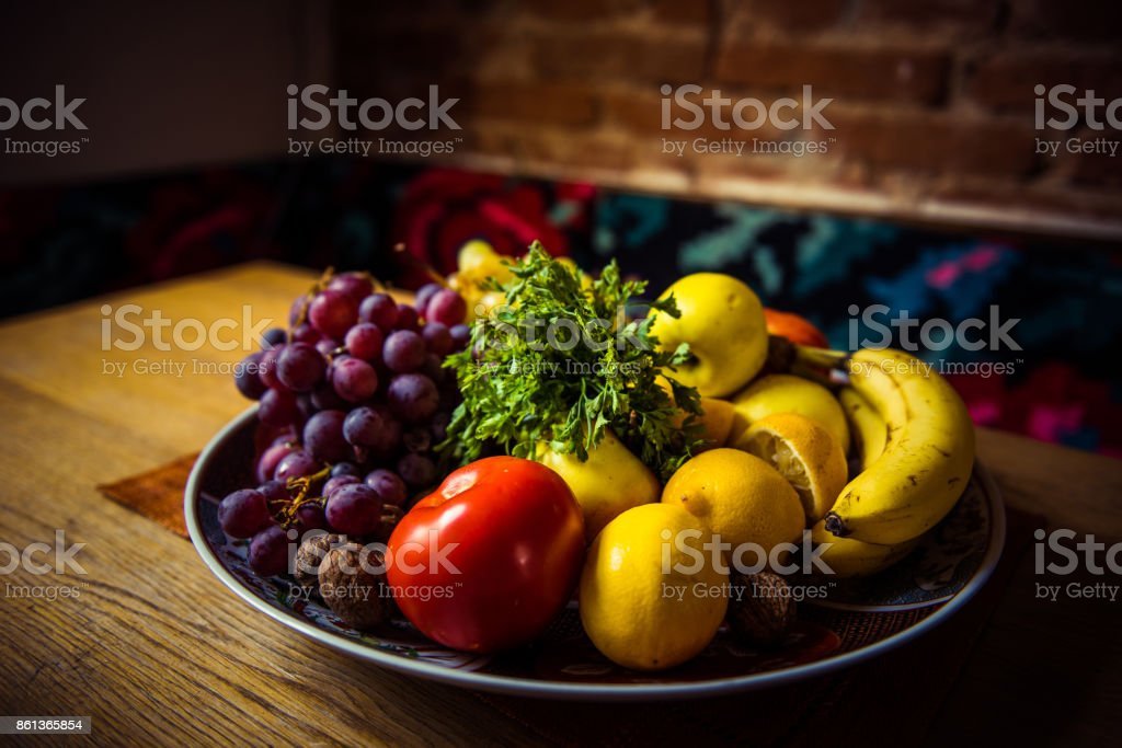 Diet fresh tasty mix fruit salad on a plate on the wooden table, healthy breakfast, weight loss concept stock photo