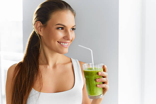 Diet. Healthy Eating Woman Drinking Juice. Lifestyle, Food.  Nutrition stock photo