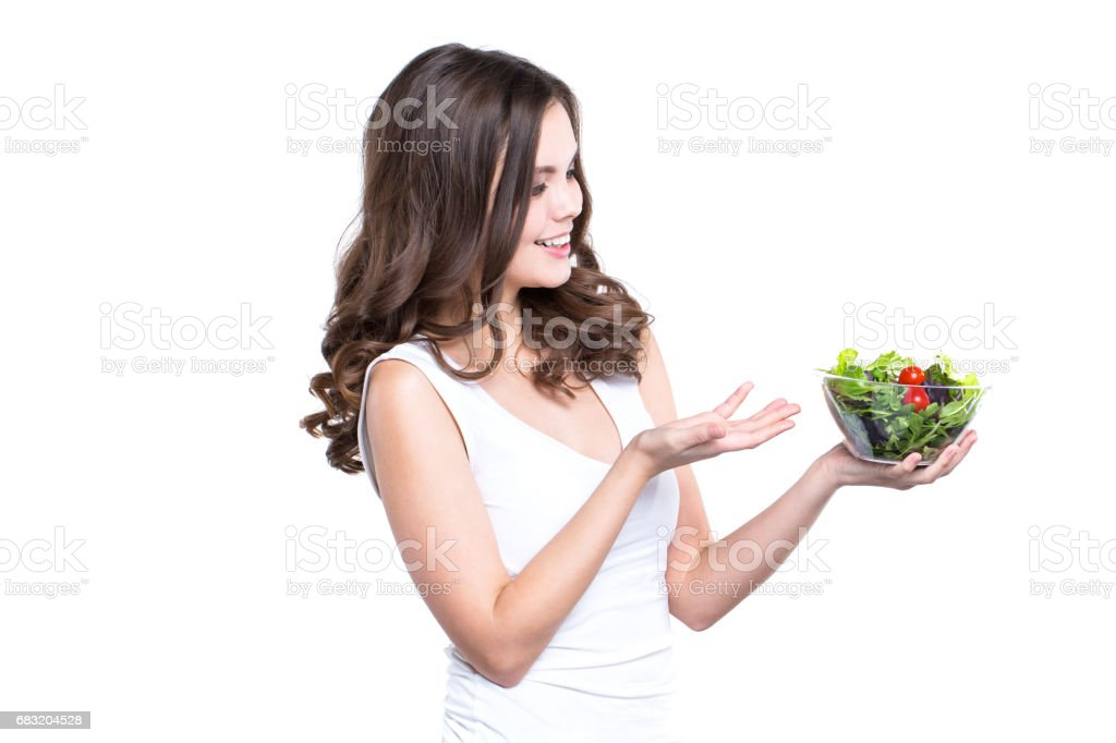 Diet. Healthy young woman with vegetable salad, Isolated. foto de stock royalty-free