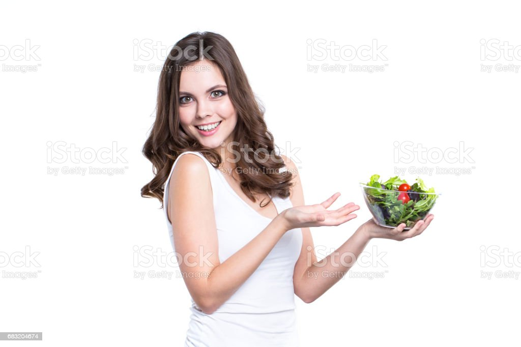 Diet. Healthy young woman with vegetable salad, Isolated. Lizenzfreies stock-foto