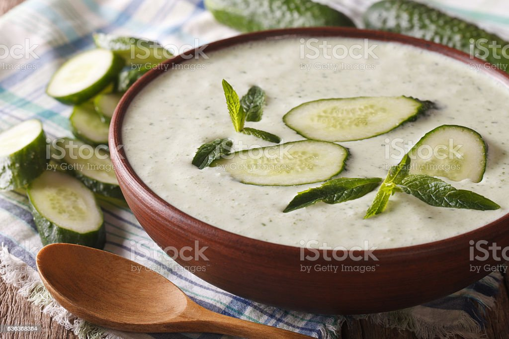 dietary cucumber soup with mint close-up in a bowl. horizontal stock photo