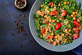 istock Dietary menu. Healthy vegan salad of fresh vegetables - tomatoes, chickpeas, spinach and quinoa in a bowl. 861847426