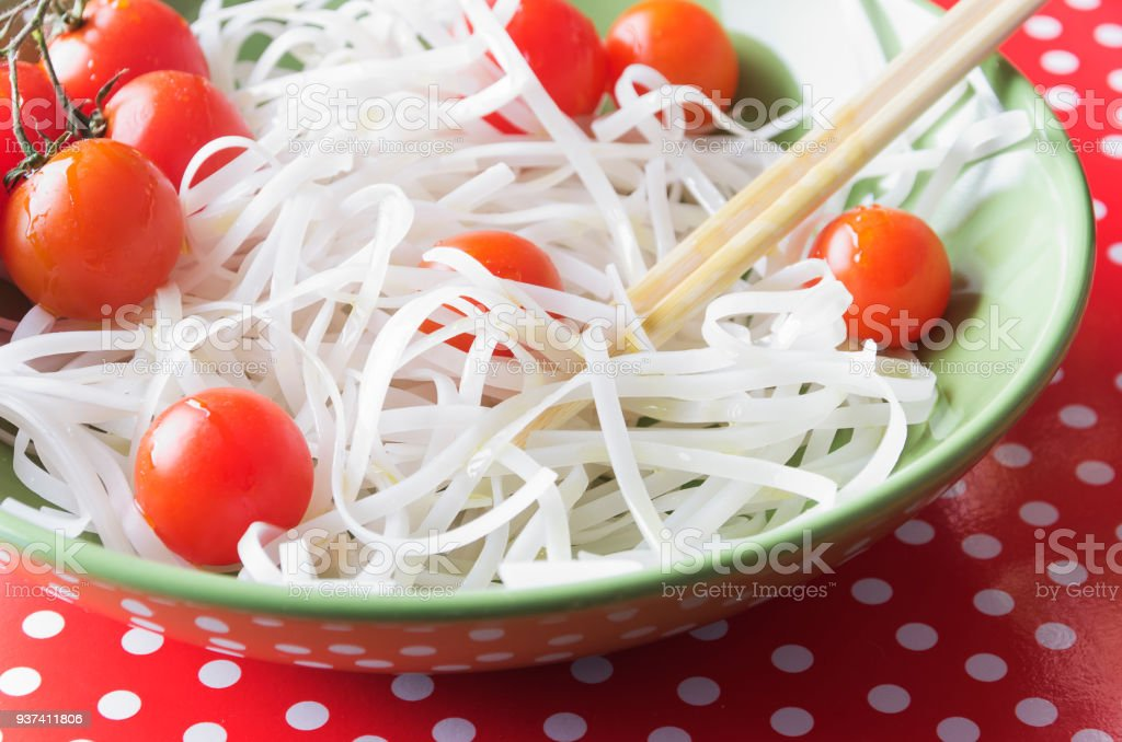 Dietary menu. Vegan cuisine. Tomatoes  and noodles - foto stock