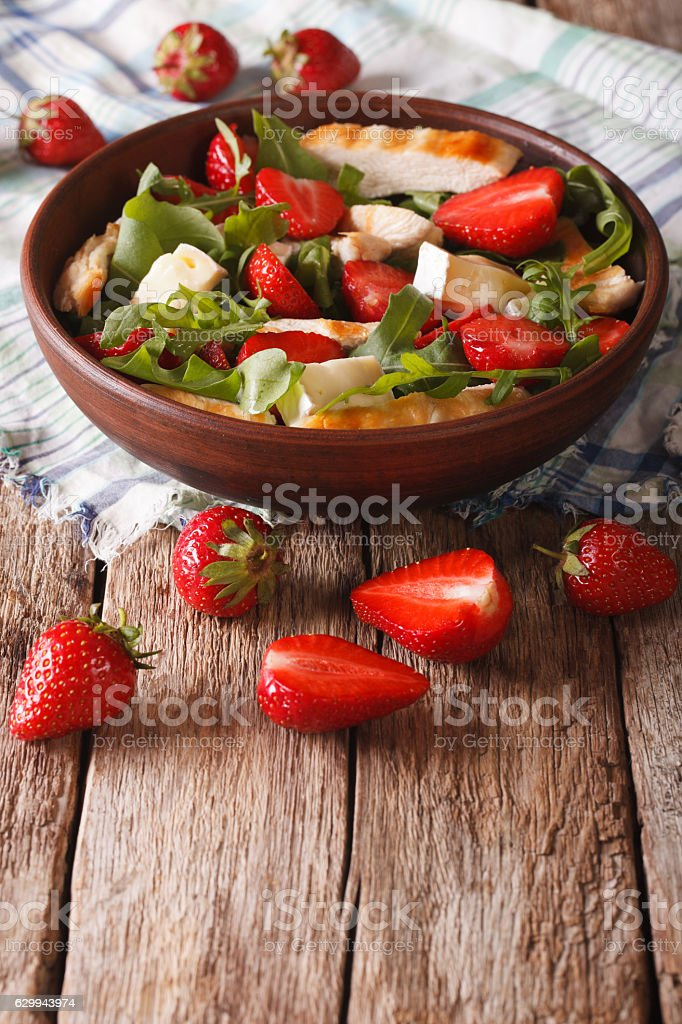Dietary salad with strawberries, grilled chicken, brie and arugula stock photo