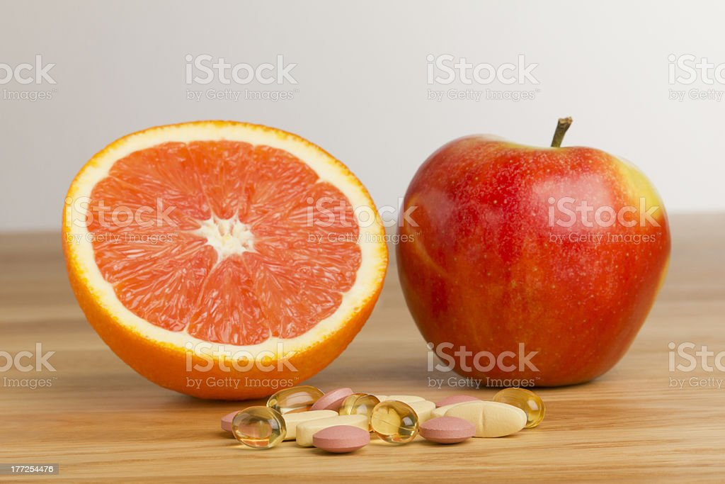 Dietary supplement vs fruits royalty-free stock photo