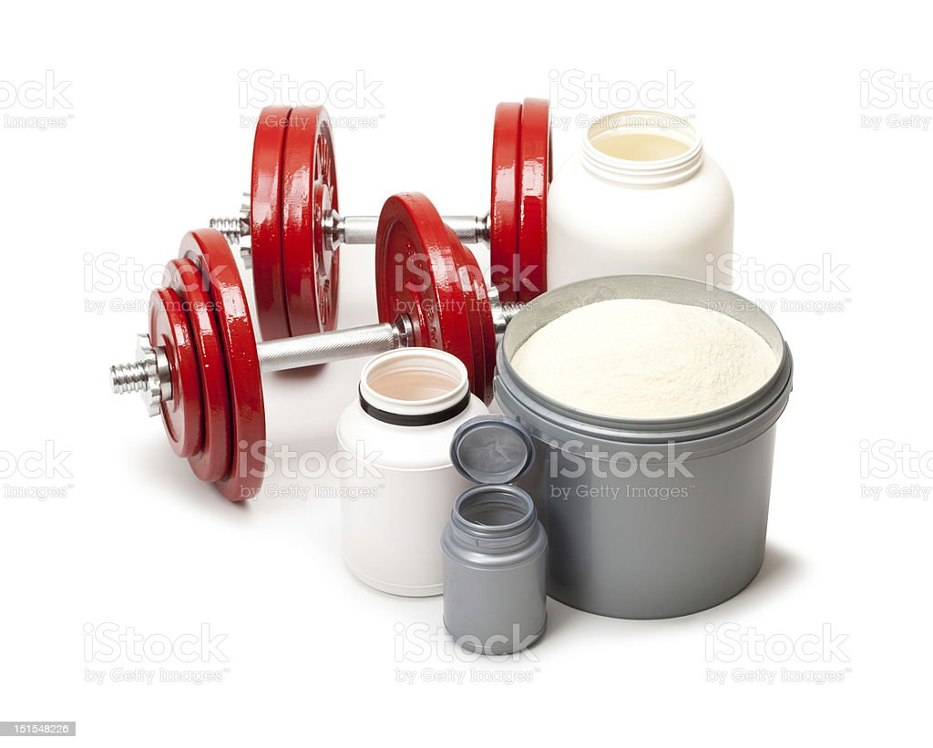 Dietary supplements and steel dumbbells royalty-free stock photo