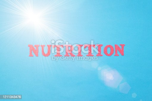 Dietetics word in red letters on a blue background. The concept of the section of medicine that deals with the clinical nutrition of patients with internal diseases