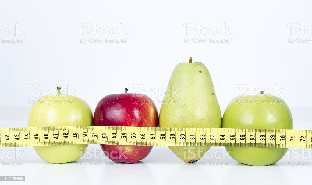 Dieting Concept Fruit with Measuring Tape on White Background stock photo