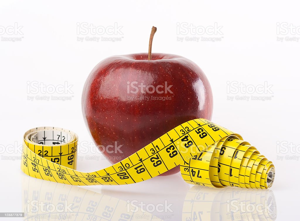 dieting concept with apple and measuring tape royalty-free stock photo