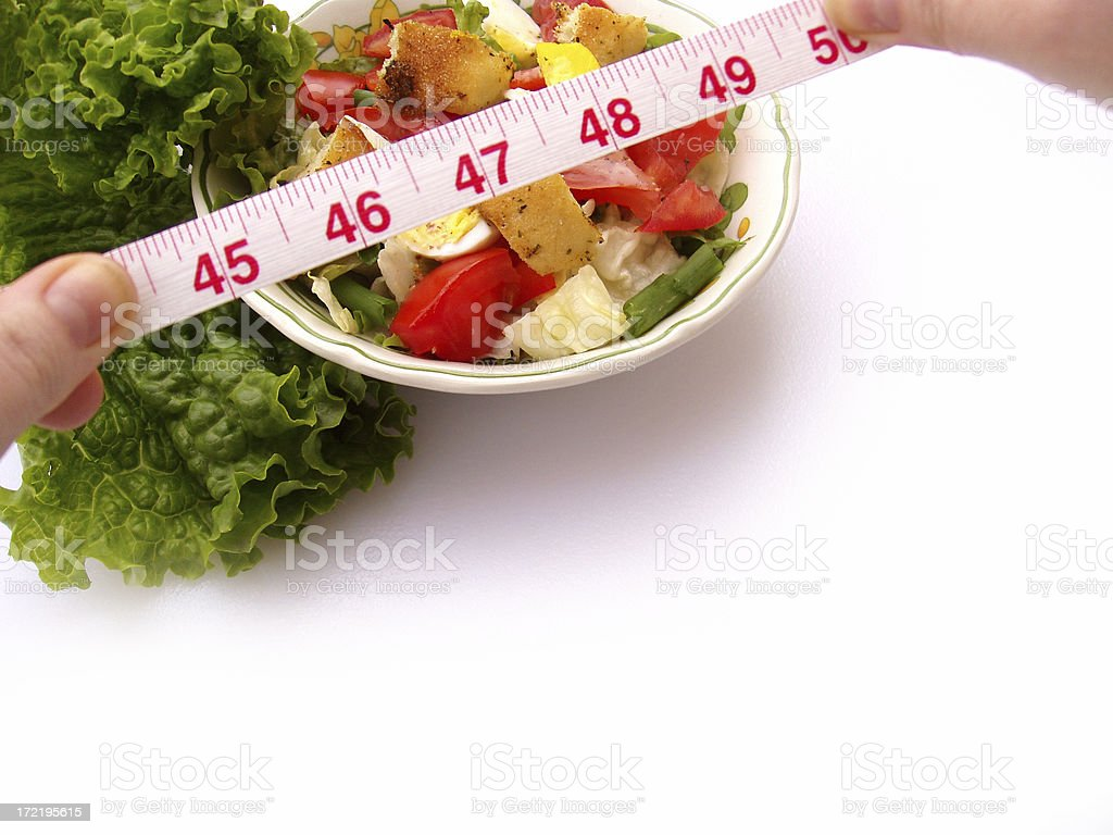Dieting - Salad with Measuring Tape royalty-free stock photo