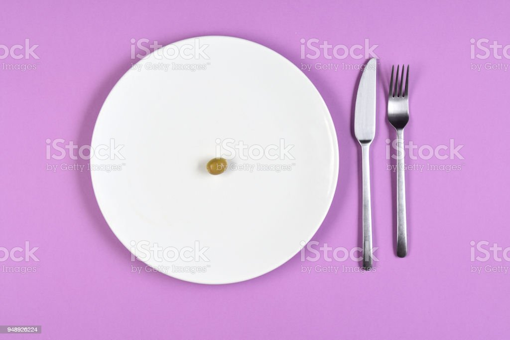 dieting with an olive stock photo