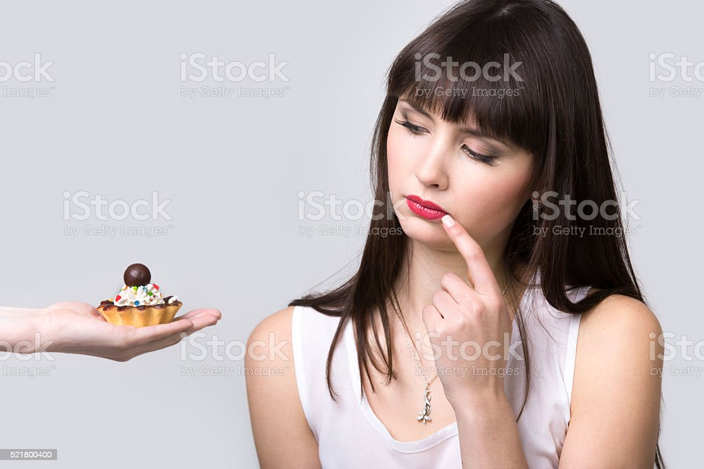 Dieting woman is offered cake stock photo