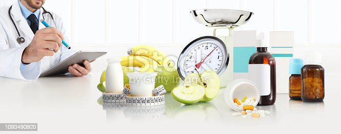 1175869940istockphoto dietitian nutritionist doctor prescribes prescription sitting at the desk office with apple, yogurt, medical drugs, tape meter and scale, healthy and balanced diet concept, web banner and copy space template 1093490920