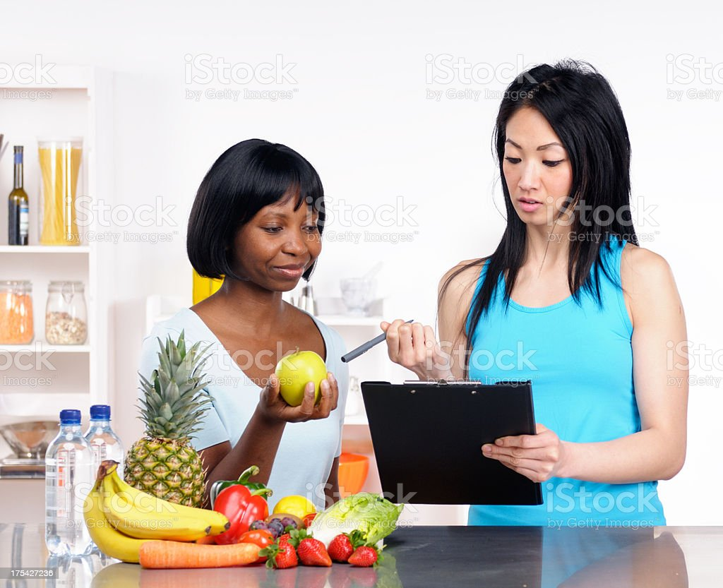 Dietitian showing client a healthy eating plan stock photo